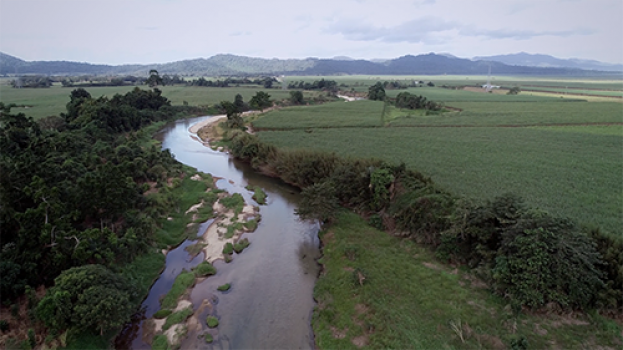 Aerial view of river running through property