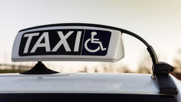 Photo of wheelchair taxi sign