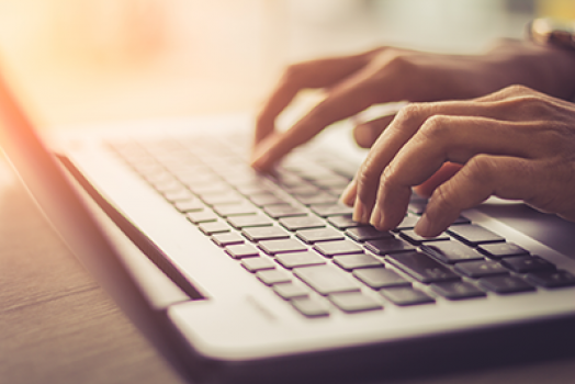 Close up of woman typing on keyboard