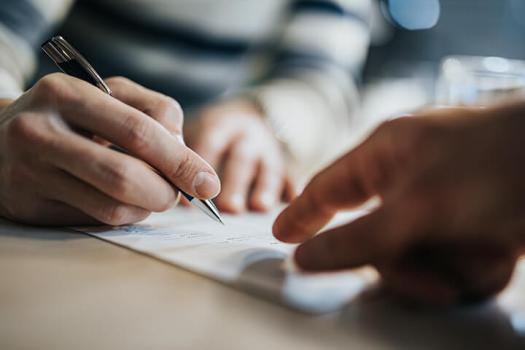 Person signing documentation